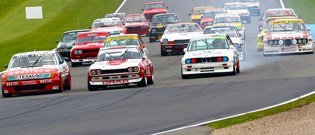 Classic touring cars in action at the Donington Historic Festival